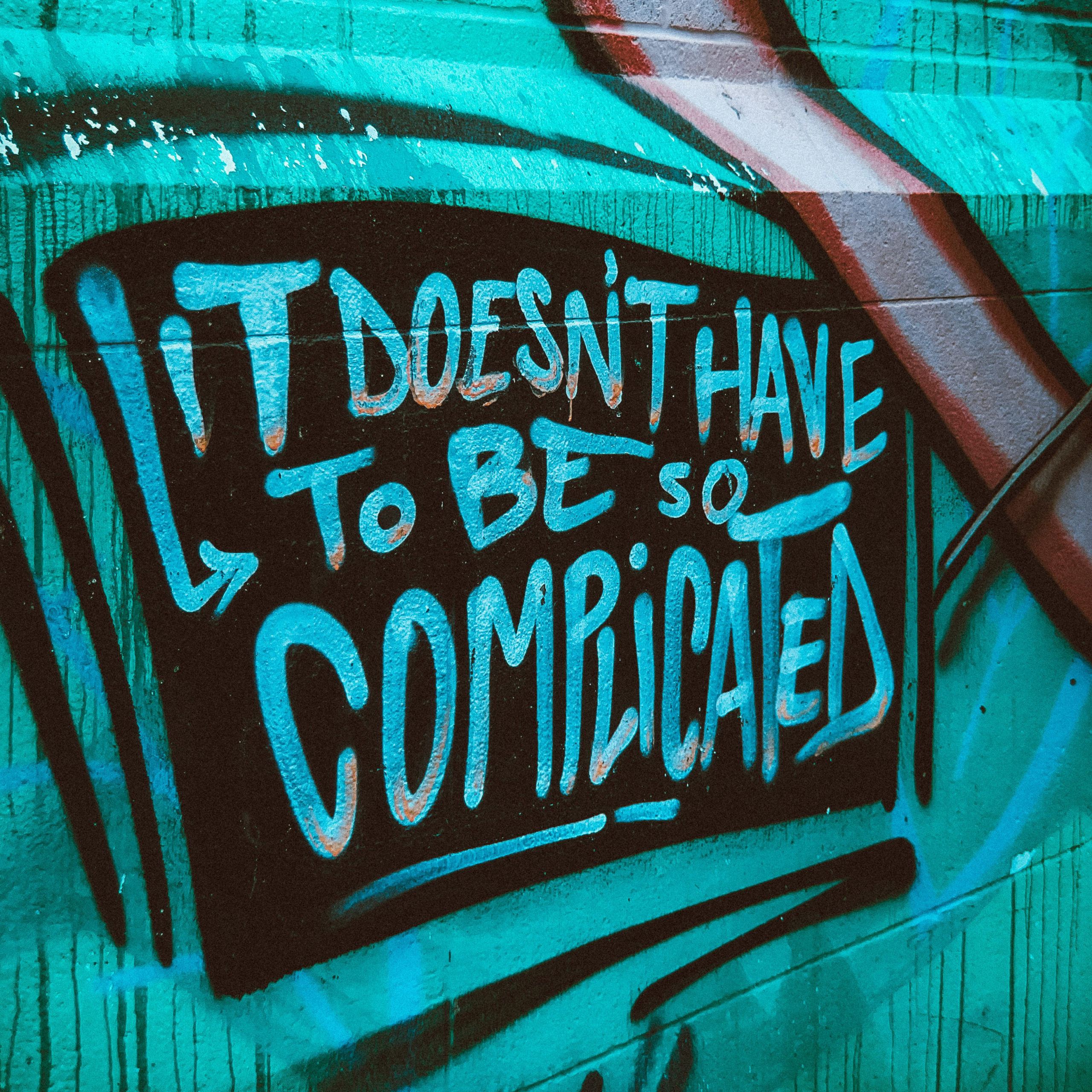 """Graffiti Mural With Message Stating """"It Doesn't Have to Be So Complicated."""""""